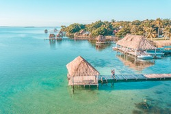 Aerial view of a Couple in Bacalar pier, Riviera Maya, Mexico