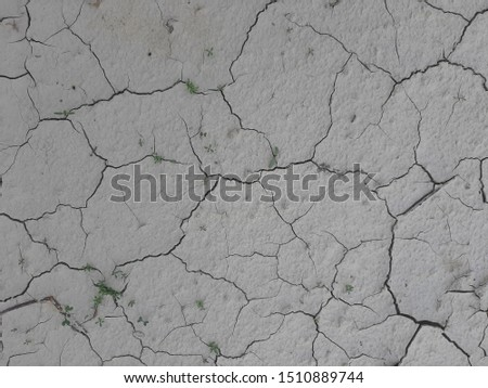 aerial view of a cracks in the ground, deep crack, cracked desert landscape, effects of heat and drought. effects of global warming, texture background #1510889744