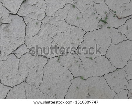aerial view of a cracks in the ground, deep crack, cracked desert landscape, effects of heat and drought. effects of global warming, texture background #1510889747