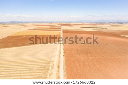 aerial view of a dirt road on a summer landscape next to Don Benito, province of Badajoz, Extremadura, Spain