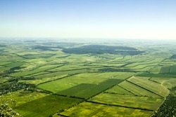 Aerial view of a green rural area under blue sky. Moldova