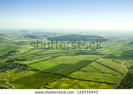 Aerial view of a green rural area under blue sky. Moldova #126918443