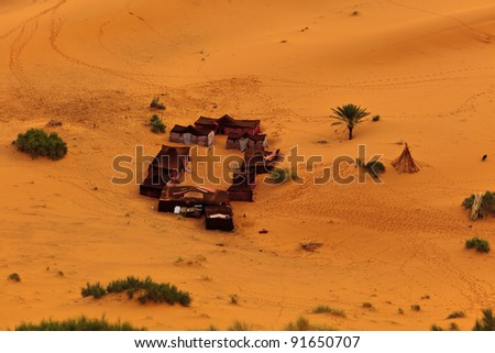 Aerial view of a group of Bedouin tents in Sahara Desert Morocco - stock photo