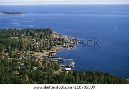 Aerial view of a harbor in a coastal village in Gastrikland, Sweden - stock photo