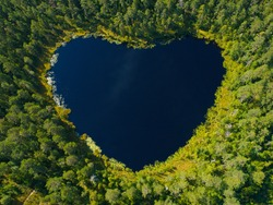 Aerial view of a heart-shaped tarn.