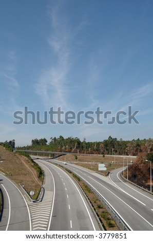 Aerial view of a highway against blue sky