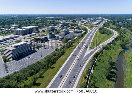 Aerial view of a highways, overpasses, ramps and buildings in a suburban Chicago suburban setting. #768540010