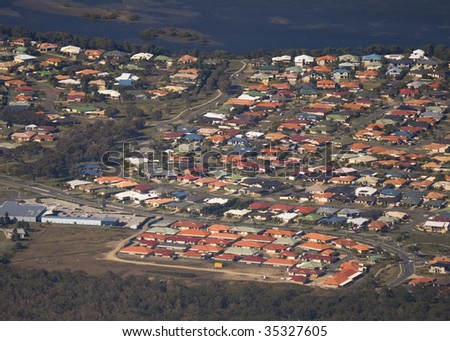 Aerial view of a housing estate in Queensland showing colorful roof tops
