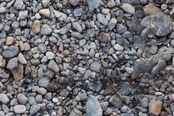 Aerial view of a large selection of pebbles which is part of an idyllic outdoor scene. Image is ready to be tiled to create a much larger image or higher resolution background, if needed.