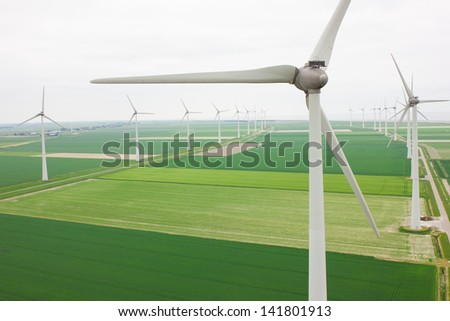 Aerial view of a many windmills