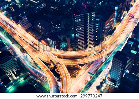 Aerial view of a massive highway intersection at night in Shinjuku, Tokyo, Japan #299770247