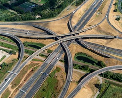 Aerial view of a multilevel cloverleaf with underpass, overpass and railway. It is the intersection were highway A4 and motorway A12 connect near The Hague in The Netherlands.