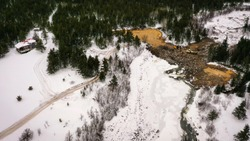 Aerial view of a natural dam in the woods of the Canadian shield.d