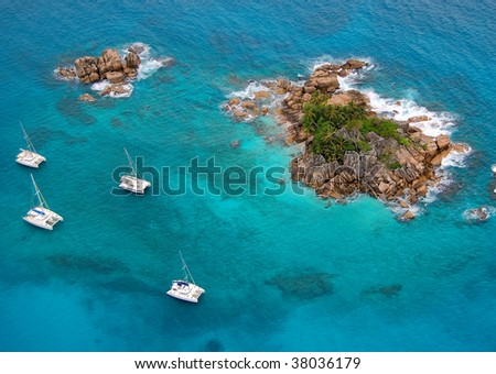 Aerial view of a paradise island with a few boats around