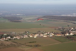 Aerial view of a paramotor flying over the commune of Soindres in the Yvelines department (78200), Ile-de-France region, France - January 03, 2010