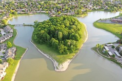 Aerial view of a peninsula located in Sterling Heights Michigan. Photo was taken in the late springtime around dusk. Drone Photography from above.