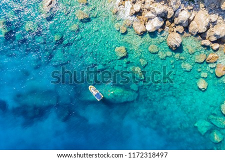 Aerial view of a rib boat with snorkelers and divers at the turquoise colored coast of the Aegean Sea in Greece ストックフォト ©