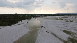 Aerial view of a river, piave view, sun behind clouds, ww1 and ww2 significant place