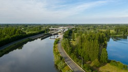 Aerial view of a road on the shore of Dender river, in Dendermonde, Belgium