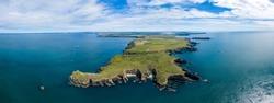 Aerial view of a rugged ocean coastline (West Wales, Pembroke, UK)
