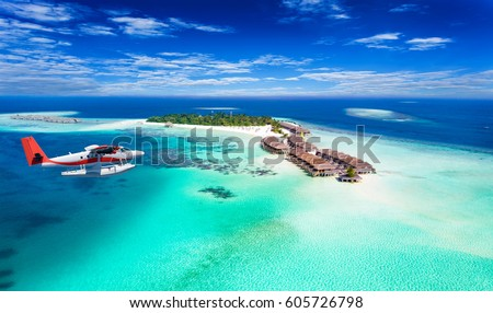 Aerial view of a seaplane approaching island in the Maldives