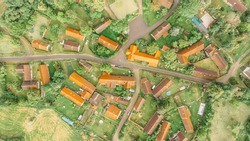 Aerial view of a small village.Top view of traditional housing estate in Czech. Looking straight down with a satellite image style.Houses from above, real estate concept.Country road urban scene