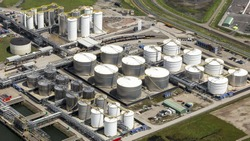 Aerial view of a state of the art terminal for storage of mineral oil products and chemicals at Rotterdam Botlek, Netherlands. All the silo's are white and silver coloured.
