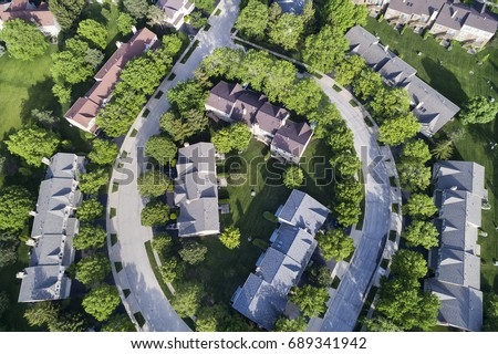 Aerial view of a townhouse complex in a circular Chicago suburban neighborhood in summer.