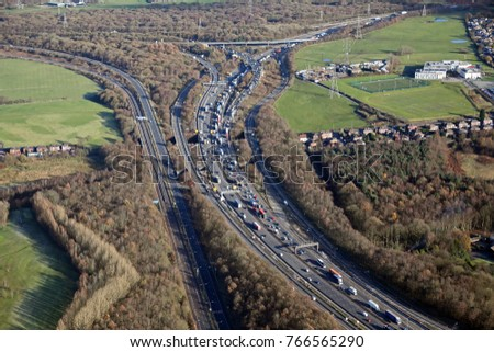 aerial view of a traffic jam at a motorway junction near Manchester, UK