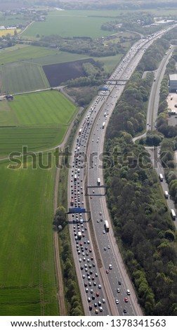 aerial view of a traffic queue looking south on the M6 motorway in Cheshire, UK #1378341563