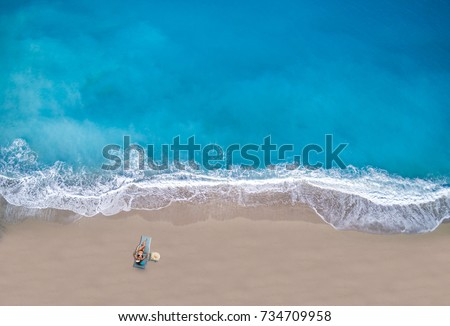 Aerial view of a Woman at the beach in Greece #734709958