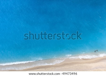 aerial view of a wonderful cyan colored beach at the Ionian sea.