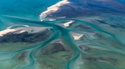 Aerial View of Abstract Tidal Water Channels Transforming Sand Banks and Shapes