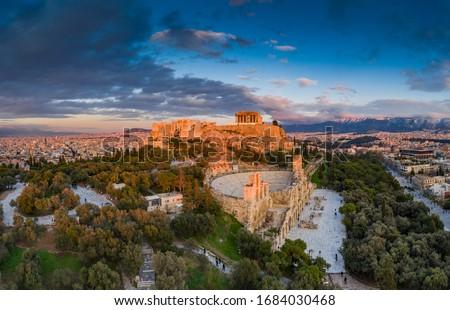 Aerial view of Acropolis of Athens, the Temple of Athena Nike, Parthenon, Hekatompedon Temple, Sanctuary of Zeus Polieus, Odeon of Herodes Atticus, Erechtheion at sunset