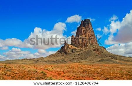 AERIAL VIEW OF AGATHLA PEAK (EL CAPITAN) IN ARIZONA, USA. DESERT, ROCK, MOUNTAIN, ROAD TO MONUMENT VALLEY. PANORAMA.