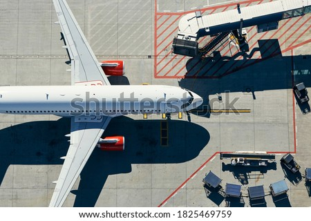 Aerial view of airport. Airplane is taxiing to gate of terminal. Сток-фото ©