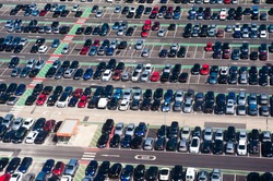 Aerial view of airport crowded parking lot full of cars