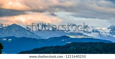 Aerial view of Alps mountains near Lucern at sunset, Switzerland #1211640250