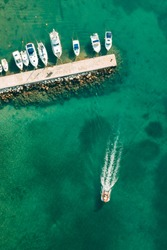 Aerial view of amazing boats in Croatia. Minimalistic landscape background with boats and sea in marina bay. Top view from drone of harbor with yacht, motorboat and sailboat. Beautiful port