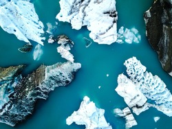Aerial view of amazing glacier patterns and shapes in Jokulsarlon lake, Iceland. Glacial lagoon with icebergs floating. Climate change, global warming, melting glacier.