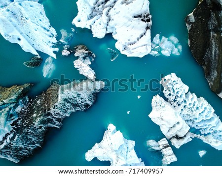 Aerial view of amazing glacier patterns and shapes in Jokulsarlon lake, Iceland. Glacial lagoon with icebergs floating. Climate change, global warming, melting glacier. #717409957