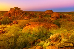 Aerial view of amazing natural landscapes whit light sun and their deep red color of Devils Marbles. These gigantic boulders have become a symbol of Australia's outback, Northern Territory, Australia.
