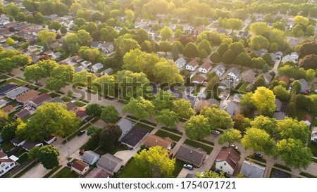 Aerial view of american suburb at summertime.  Establishing shot of american neighborhood. Real estate, residential houses. Drone shot, from above ストックフォト ©