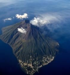 Aerial view of an active volcano. Ginostra island and Stromboli volcano smoking - Eolie islands, Sicily, Italy - November 2014