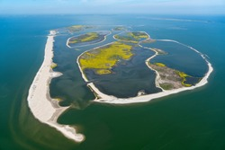 Aerial view of an artificial island in Lake Markermeer, Holland. These 'Marker Wadden', mud flats, form a unique ecosystem that will boost biodiversity in the Netherlands. IJsselmeer on the horizon.