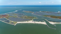 Aerial view of an artificial island in Lake Markermeer, Holland. These Marker Wadden will form a unique ecosystem that will boost biodiversity. A small harbour and some buildings for tourists.