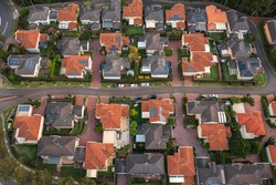 Aerial view of an average neighbourhood of similar detached houses built around 2000-2010, outer Sydney, Australia.