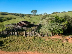 Aerial view of an old cattle wooden stable abandoned in Brazil