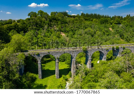 Aerial view of an old Victoria viaduct in a green valley on a beautiful summers day (Pontsarn Viaduct) Photo stock ©