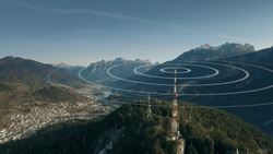 Aerial view of antennas transmitting radio signals in rural mountainous area